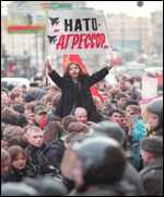 [ image: A demonstrator in Moscow holds a placard reading