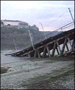 [ image: Serbian TV showed the wrecked bridge]