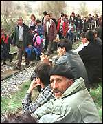 [ image: Albanian border: The queue of refugees stretches miles back into Kosovo]