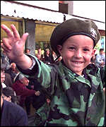 [ image: A child gives the Serb salute]