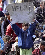 [ image: A refugee at Blace cries for help]
