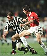 [ image: Keane battles to get the ball off Juve playmaker Zidane]