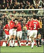 [ image: Giggs is congratulated by his team-mates after his goal]