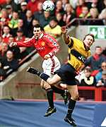 [ image: Ryan Giggs and Lee Dixon jump for the same ball]
