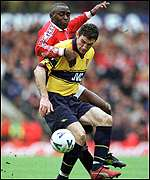 [ image: Martin Keown holds off Andy Cole]