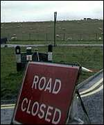 [ image: Road closed: A familar site for revellers]