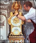 [ image: A Louis XVI clock is prepared for the auction]