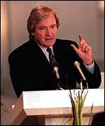 [ image: William Roache addressing the congregation]