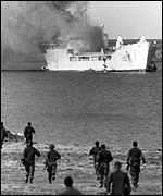 RFA Sir Galahad is on fire during the Falklands War