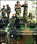 [ image: French soldiers patrol the Kosovo border]
