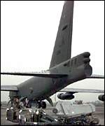 [ image: An air-launched cruise missile is loaded on a B-52]