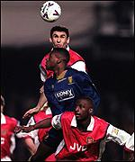[ image: Arsenal's Martin Keown challenges Carl Corte]