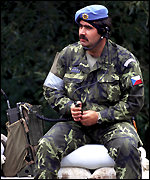 [ image: Czech soldier in the first Partnership for Peace Mission, 1991]