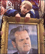 [ image: Demonstrators carried pictures of President Milosevic]