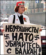[ image: 'Nato neo-fascists,' reads this Russian sign]