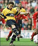 [ image: Overmars converts from the spot to put Arsenal ahead]