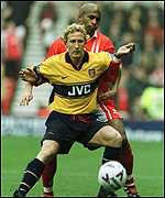 [ image: Arm lock: Ray Parlour holds off the attentions of Dean Gordon]