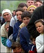 [ image: Refugees queue for aid from Kuwait]