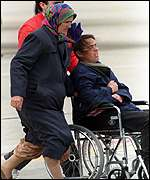 [ image: Refugees arrive in Spain, part of the airlift from Macendonia]
