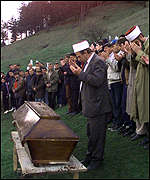 [ image: Refugees bury a former neighbour killed Roxhaje attack]