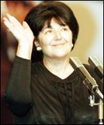 [ image: Mrs Markovic waves after her speech to the Yugoslav Left Union in 1996]