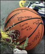 [ image: A signed basketball was one of many tributes to a popular sports coach]