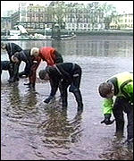 [ image: Police search the bank of the Thames]