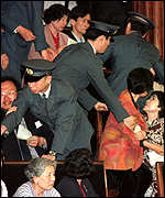 [ image: Security guards removed some people from the public gallery of the lower house]