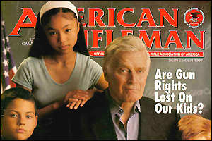 Charlton Heston with children on the cover of American Rifleman