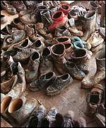 [ image: Muddy shoes on the steps of the mosque]