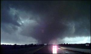 [ image: A lone Oklahoma motorist tries to escape a tornado]