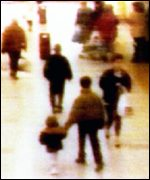 [ image: James Bulger being led away to his death]