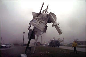 [ image: The remains of a cross in front of a church in Moore]