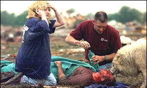 [ image: Residents of Oklahoma City try to comfort an injured man]