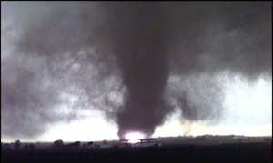[ image: A funnel cloud smashes into a house in Oklahoma]