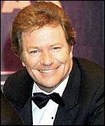 [ image: Jim Davidson: Regularly works entertaining British troops]
