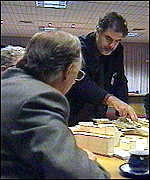 [ image: Architect Enric Miralles discusses the plans with Donald Dewar]