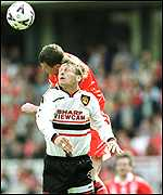 [ image: Heads you lose: Gary Pallister beats Teddy Sheringham to the ball]