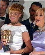 [ image: EastEnders stars celebrate their Bafta]