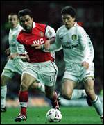 [ image: Wing generals: Harry Kewell and Marc Overmars]