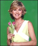 [ image: One time Blue Peter girl Anthea Turner posed with just a python]