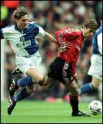 [ image: Stephane Henchoz and Phillip Neville contest possession]
