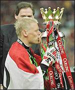 [ image: A dream finale as Schmeichel secures the Premiership trophy on his last league appearance]