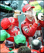 [ image: Double joy: Michael Schumacher and Eddie Irvine join the celebrations]