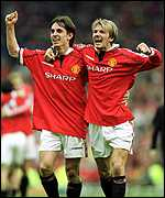 [ image: Gary Neville and goalscorer David Beckham take the acclaim]