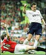 [ image: United skipper Roy Keane tackles Justin Edinburgh]