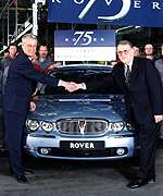 [ image: Werner S�mann (left) celebrates the Rover 75]