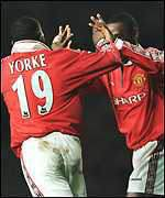 [ image: Dwight Yorke celebrates scoring another goal with strike partner Andy Cole]