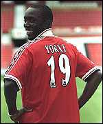 [ image: Dwight Yorke wears his usual grin after signing for Manchester United]