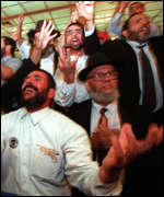 [ image: Shas supporters celebrate the party's results]